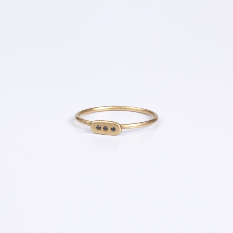 Thin Rectangular element ring with three Black Diamonds